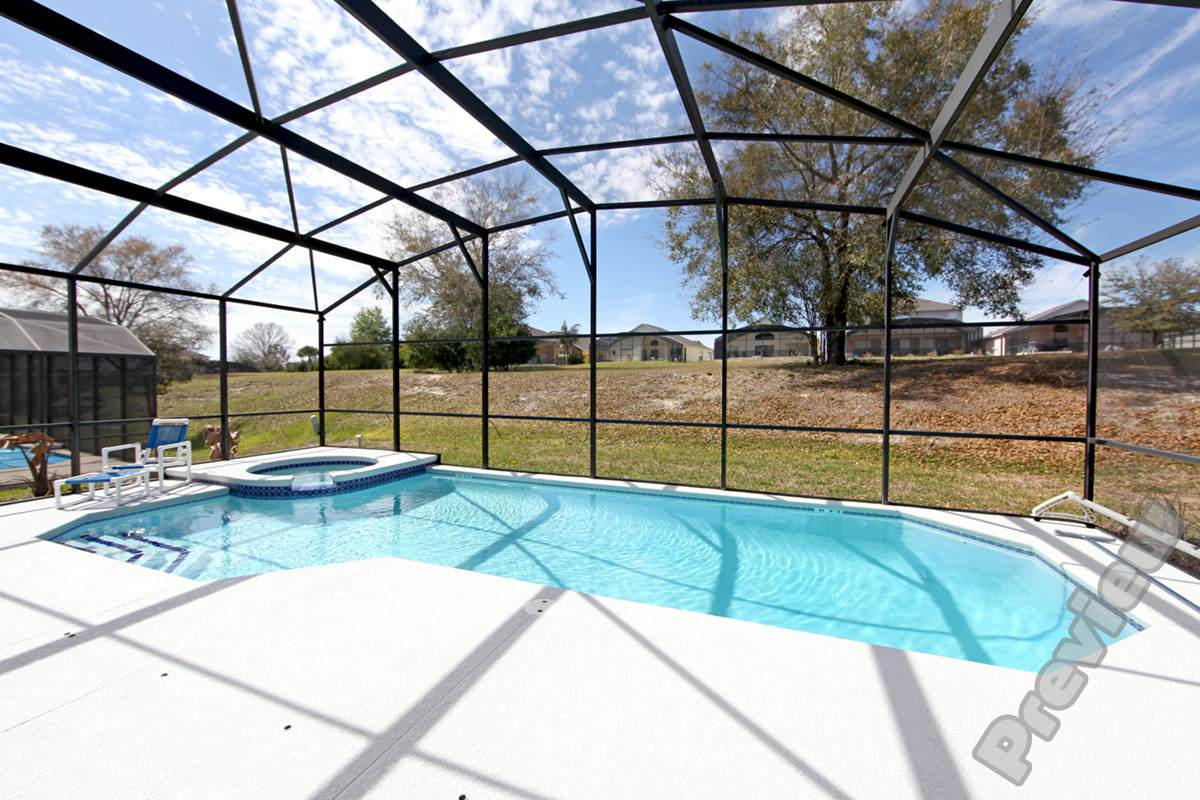 A Swimming Pool And Spa At A Home In Florida Diversified Pool Pros Inc